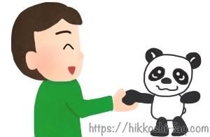 サカイ引越センターのパンダと握手をしている人です。